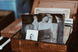 - Looking through a box of photos in a care home