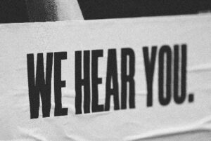 - 'We hear you' slogan representing how we're listening to care home residents and their families